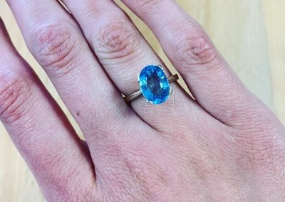 Gold and blue topaz ring
