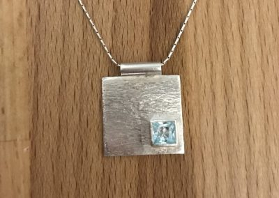 Square silver pedant with blue topaz