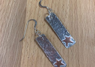 Silver and copper star earrings