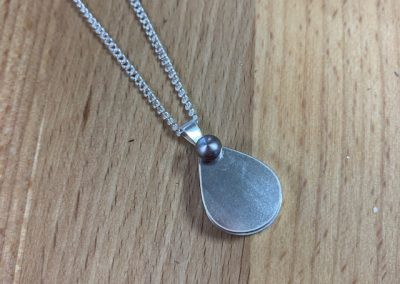 Silver swing locket