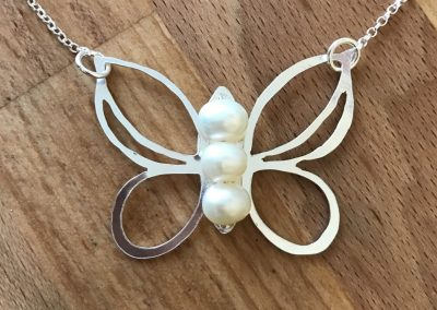 Silver and pearl butterfly