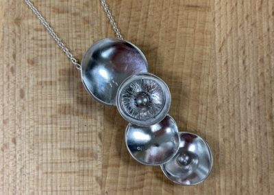 Silver domed pendant