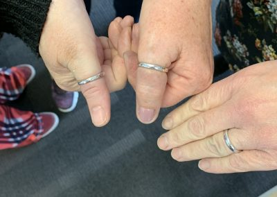 Group of hands showing silver rings