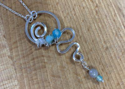 Silver and blue bead swirl pendant