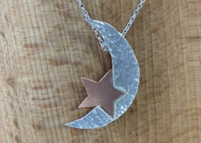 Silver and copper moon and star pendant