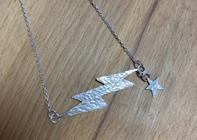 Silver lightening and star necklace