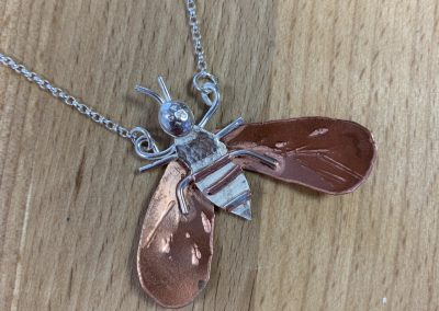 Silver and copper bee pendant