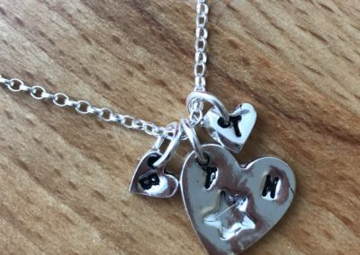 Silver art clay charm necklace
