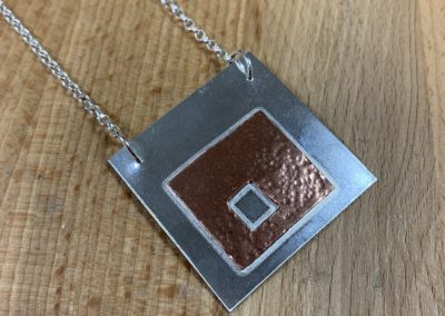 Silver and copper square pendant