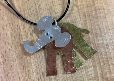 Moveable elephant pendant