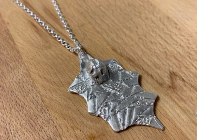 Silver clay holly and skull pendant