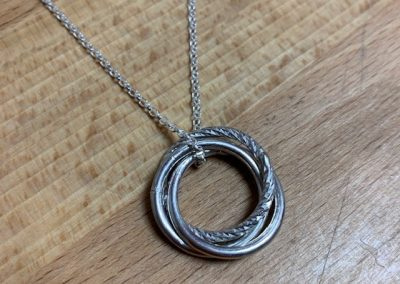 Silver interlocking pendant