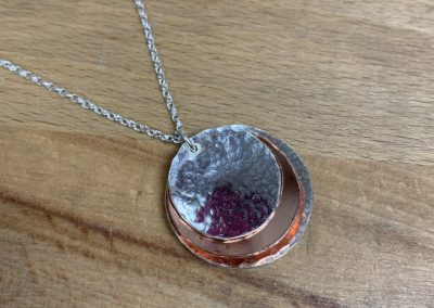Silver and copper circle pendant