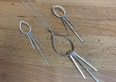 ilver drop pendant and earrings