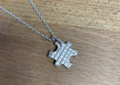 Silver clay puzle piece pendant
