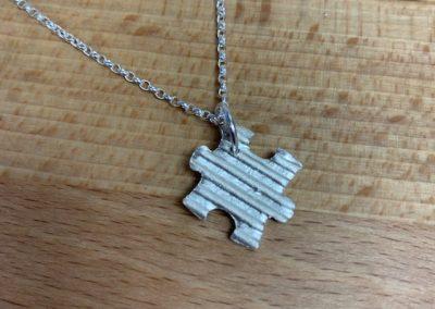 Silver art clay puzzle piece