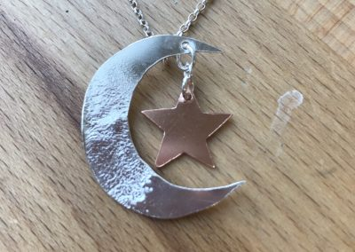 Moon and star pendant made on Beginners Silver Jewellery Making at Hampshire School of Jewellery in Basingstoke