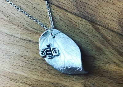Silver art clay leaf and bee pendant