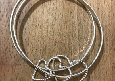 Double bangle with heart charms