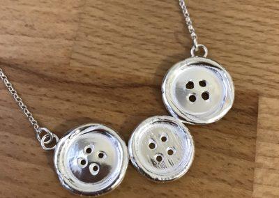 Silver caly button pendant