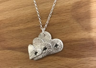 Heart pendant made in silver clay